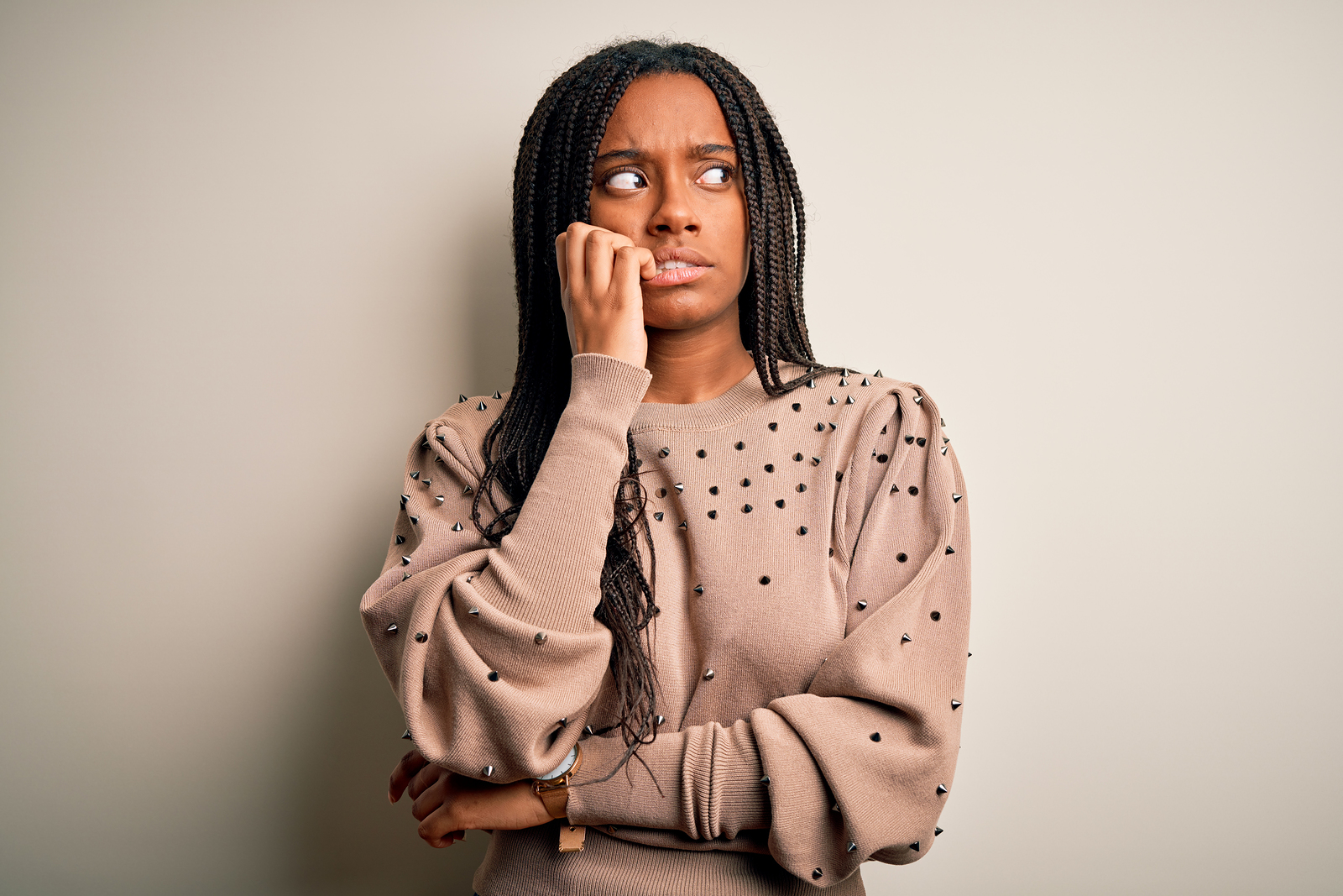 Black woman in beige sweater bitting nails and looking worried. When you're going through changes life is stressful. Whether good or bad, therapy for life transitions in Detroit, MI can help you breathe. Whether you need caregiver support, support for mom burnout, or relationship therapy for singles. We are here to help!
