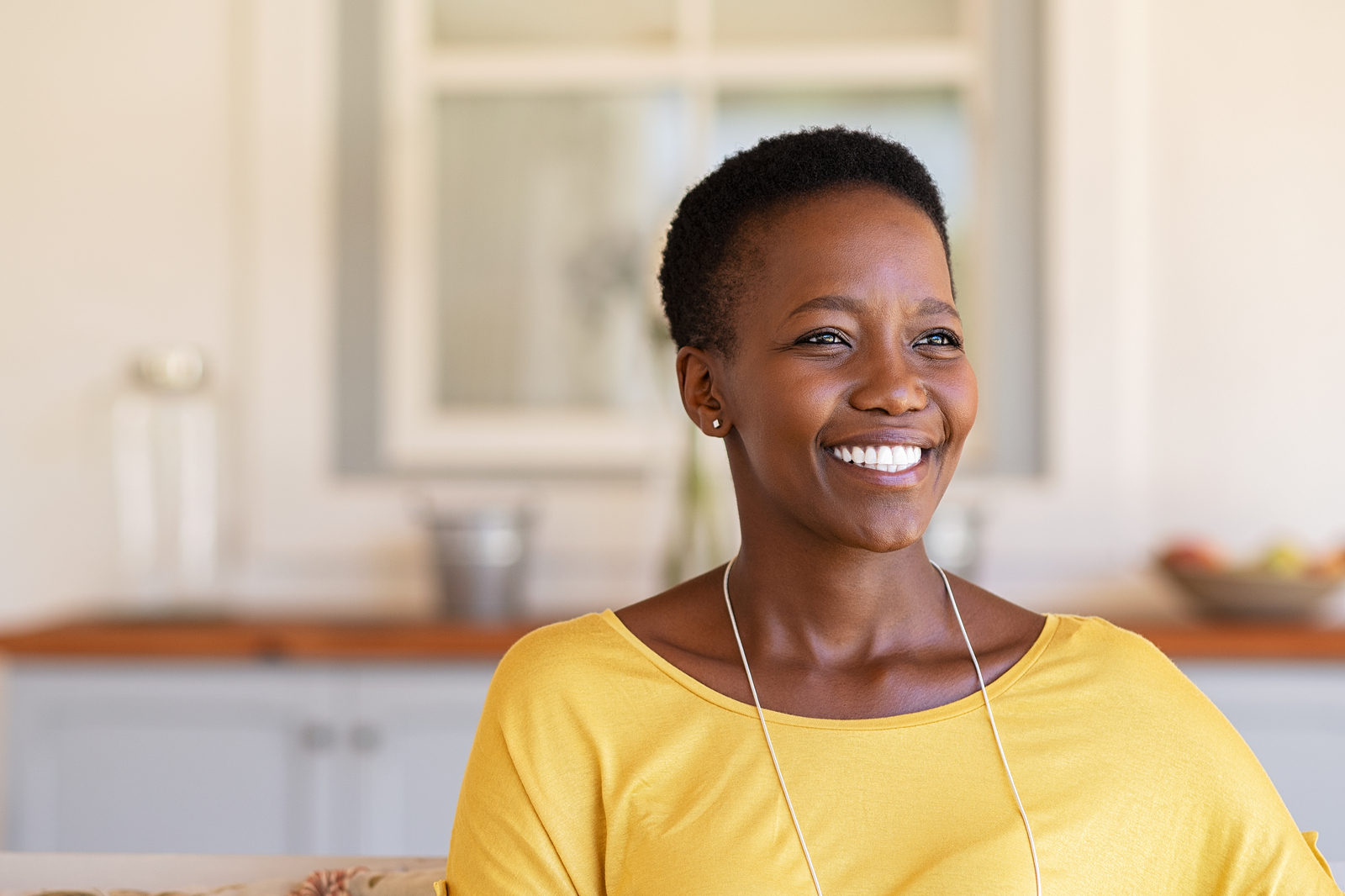 Older black woman smiling. Life is full of transitions. Whether you're an older adult with parents needing caregiver support. A young adult needing relationship therapy for singles, or an overwhelmed mom needing support from mom burnout, our therapists are here to guide you!