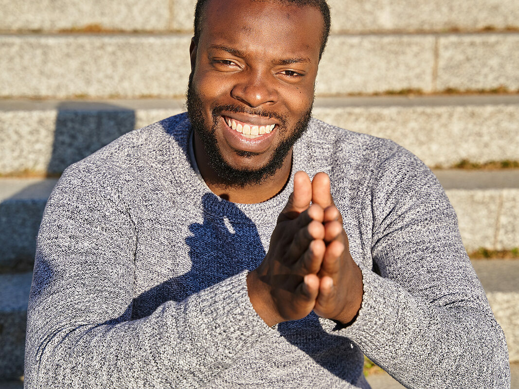 Happy and smiling close up of black man. Regardless of where you are and who you're our black therapists are here to support you in online therapy in Detroit, MI or statewide. We offer therapy for women and therapy for men. Call now for support!