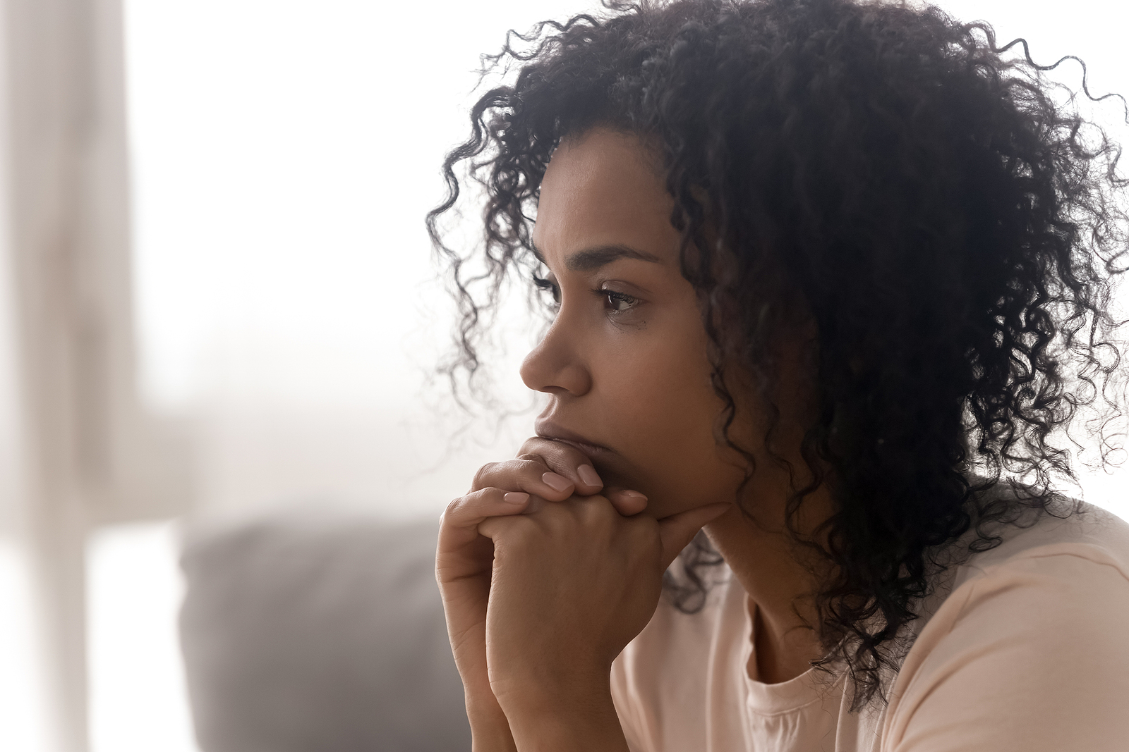 """Woman in close up dealing with the loss of a loved one. Regardless of how grief occurs, it effects everyone. Finding grief counseling near """"Detroit, may help. Begin working with a skilled grief therapist and begin experiencing hope and a path to move forward."""