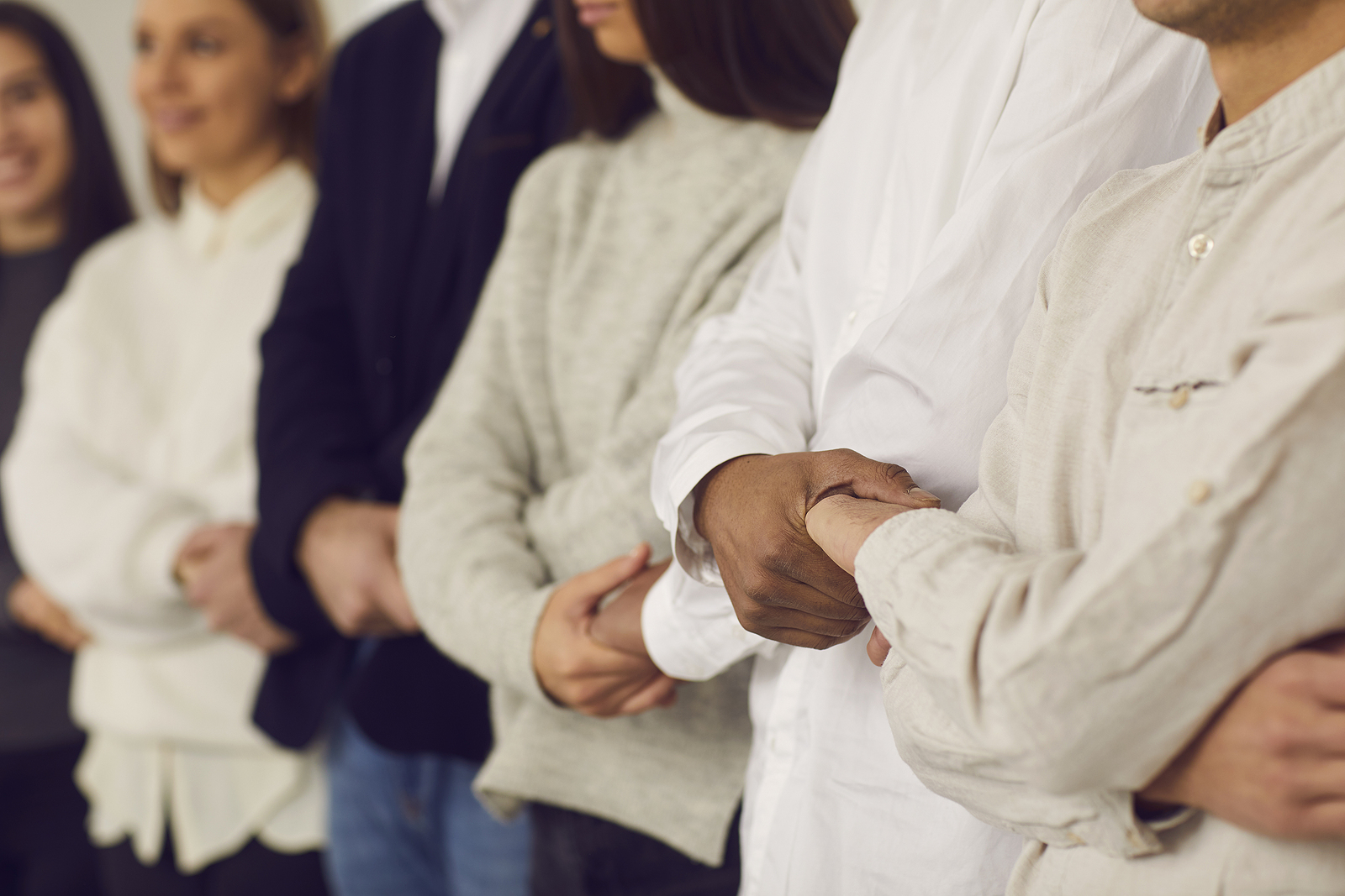 Group of woman holding hands in support. When your support is gone, finding a new one matters. Why not begin grief counseling in Detroit, MI and start taking care of your mental well being with a grief therapist who gets it.