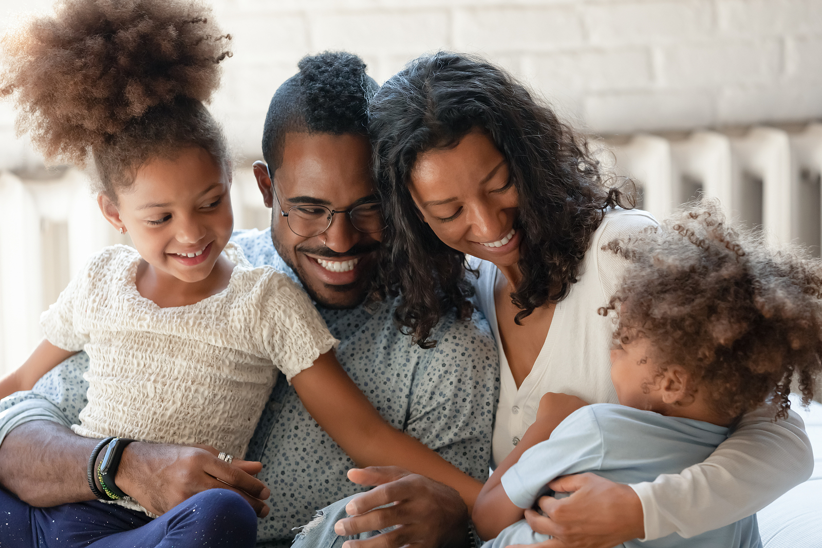 Family enjoying time together. Trauma takes many forms including intergenerational trauma. Get support with this in PTSD treatment and trauma therapy in Detroit, MI. Begin overcoming perfectionism and childhood trauma, anxiety and trauma, or depression and trauma soon!