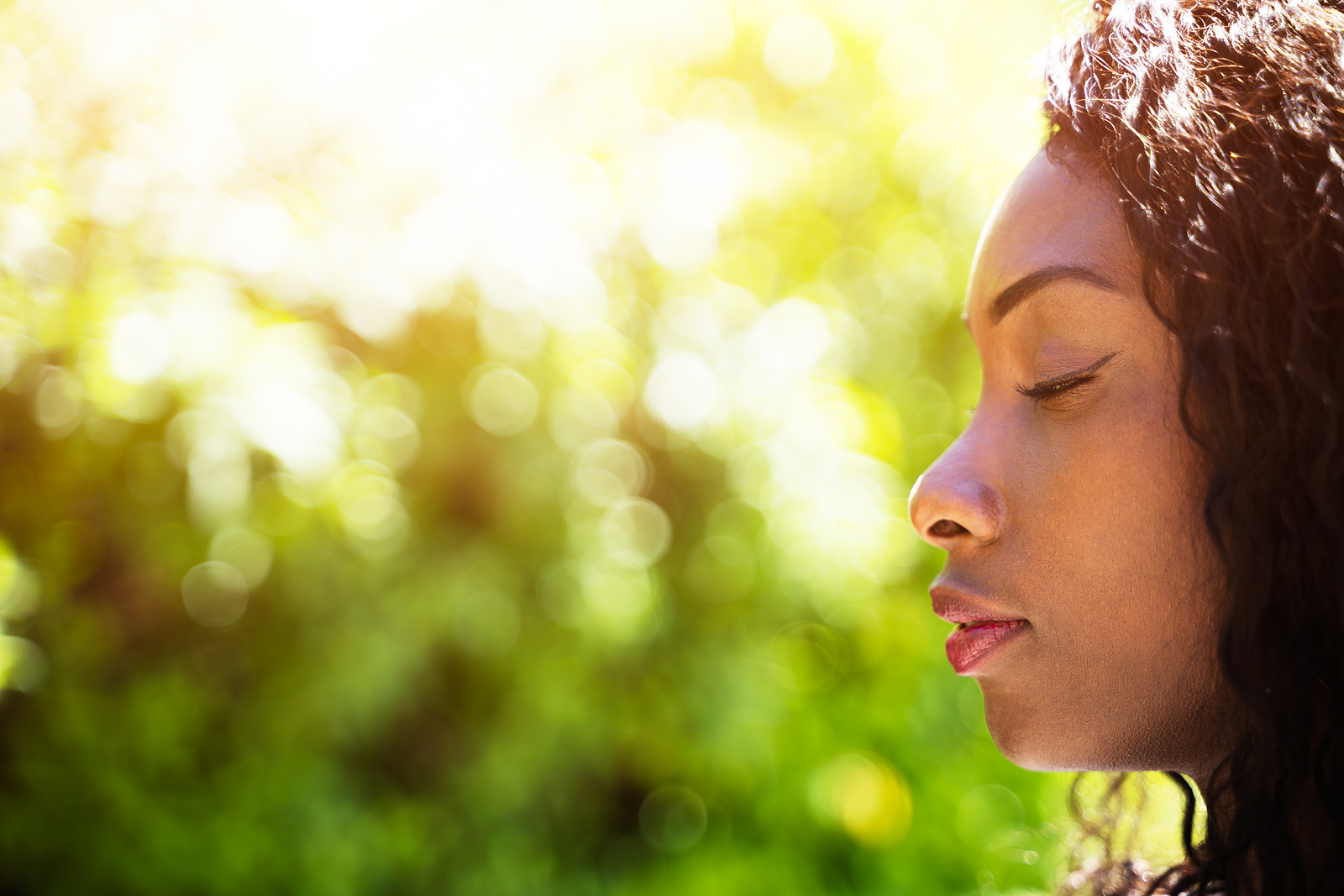 Close up of black woman outside breathing deeply. When you're struggling with being in the present moment, ACT therapy can help you feel grounded. Begin in-person or online therapy in Michigan for Acceptance and Commitment in Detroit, MI. Call now!