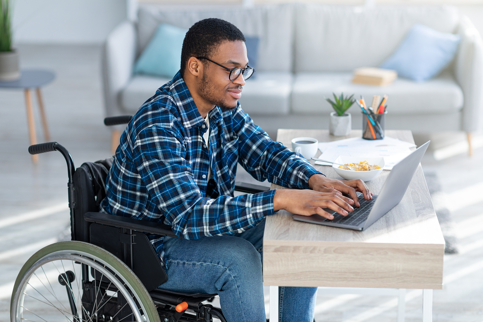 Man in wheel chair on laptop. If you're struggling to overcome the trauma of an injury or are grieving, our EMDR therapists are here to help. Find EMDR therapy near me, and begin to find healing today. Try EMDR therapy in Detroit, MI for support!