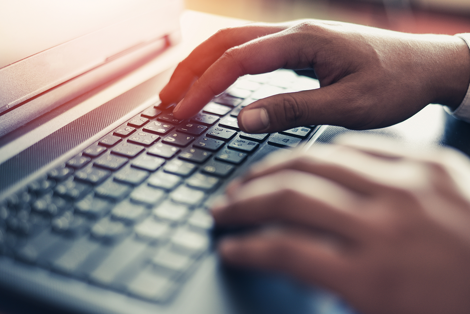 Business man typing on computer. Online therapy in Michigan is a great way to get accessible services. Our online therapists would love to work with you from the comfort of your space. When you're ready, reach out to Introspective counseling for online therapy in Detroit, MI today!