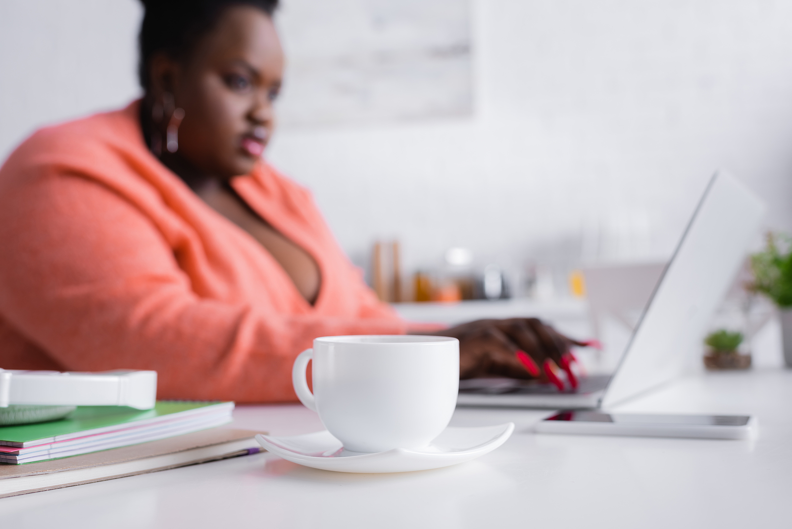 Woman typing on computer in pink sweater. Perfection is impossible. So why have impossible standards? Begin overcoming perfectionism in detroit, mi. Our online therapists who provide anxiety treatment and perfectionism treatment. Learn about how therapy for anxiety and perfectionism today!